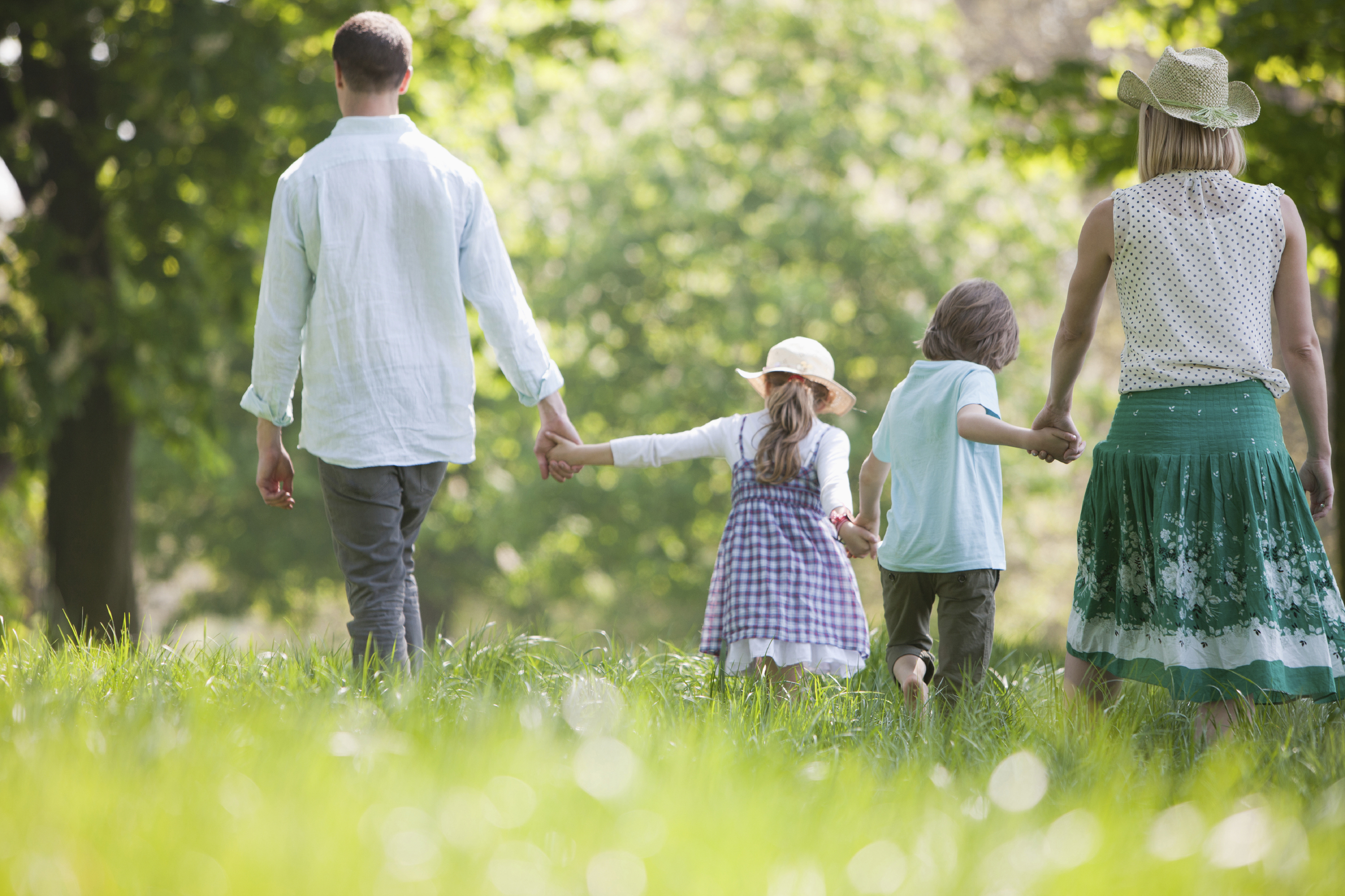 Family walking in field of flowers at Stage Nature Center in Spring
