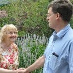 Ann Neuser - ICS Chairperson greeting a friend